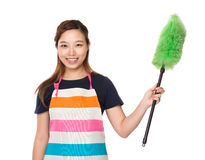 Housewife hold with duster brush Royalty Free Stock Image