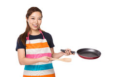 Housewife hold with pan and wooden ladle Stock Image