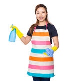 Housewife hold with rag and water spray Stock Photo