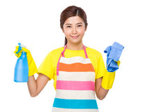 Housewife hold with spray and towel Royalty Free Stock Photography