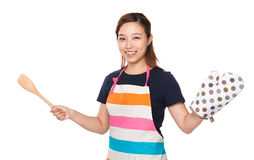 Housewife hold with wooden ladle and oven gloves Royalty Free Stock Photography