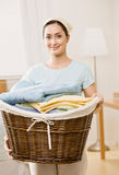 Housewife holding basket of laundry Royalty Free Stock Photos