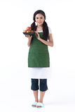 A housewife holding a bowl of apples Stock Photography
