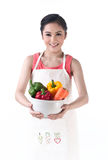 Housewife holding a bowl of vegetables Royalty Free Stock Photos