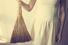 Housewife holding a broom. Housewife a broom in his hand on a white background Royalty Free Stock Photography