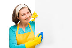 Housewife holding a brush and a poster for the inscription Royalty Free Stock Photo
