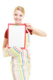 Housewife holding clipboard with copy space for text. Royalty Free Stock Photos