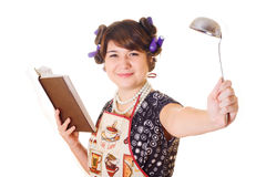 Housewife holding a cookbook Royalty Free Stock Photography