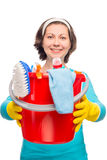 Housewife holding hands in a bucket with cleaning products Royalty Free Stock Image