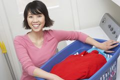 Housewife Holding A Laundry Basket Royalty Free Stock Image