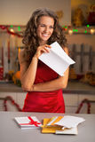 Housewife holding letter in decorated kitchen Royalty Free Stock Photos