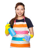 Housewife holding rag and detergent spray Royalty Free Stock Photography