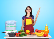 Housewife holding rolling pin Stock Photography