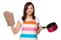 Housewife holding with saucepan and oven glove. Isolated on white background Stock Photo