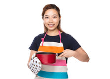 Housewife holding saucepan with oven gloves Royalty Free Stock Photo