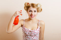 Housewife holding spray Stock Photos
