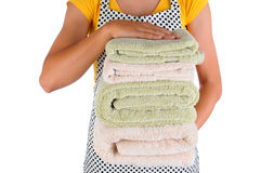 Housewife Holding a Stack of Towels Stock Images