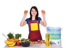 Housewife holding tomato Stock Image