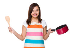 Housewife holding with wooden ladle and saucepan Stock Photography