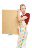 Housewife holds wooden board with copy space Royalty Free Stock Photo
