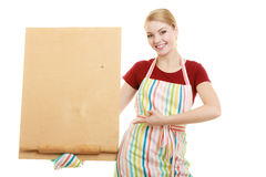 Housewife holds wooden board with copy space Stock Photos