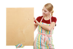 Housewife holds wooden board with copy space Stock Image