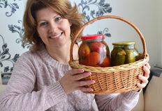 housewife with home canned vegetables in room Royalty Free Stock Images