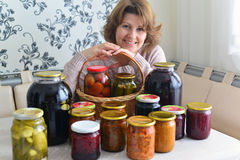 housewife with home canned vegetables in room Stock Image