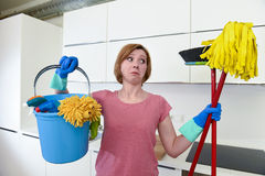 Housewife at home kitchen in gloves holding cleaning broom and mop and bucket Royalty Free Stock Photos