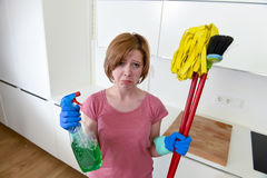 Housewife at home kitchen in gloves holding cleaning broom and mop and spray bottle Stock Photography