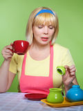 Housewife  at home with a  red cup Royalty Free Stock Image