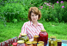 Housewife with homemade pickles and jams in  garden Stock Images