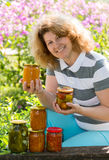 Housewife with a homemade preserves in  garden Royalty Free Stock Photo