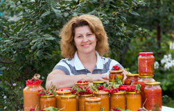Housewife with a homemade preserves in  garden Stock Photography