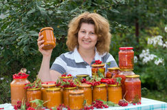 Housewife with a homemade preserves in  garden Stock Images