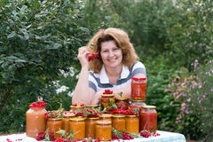 Housewife with a homemade preserves in  garden Stock Image