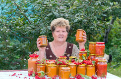 Housewife with a homemade preserves in  garden Royalty Free Stock Photos