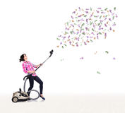 Housewife  hoovering euro bills Royalty Free Stock Photography