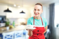 Housewife or housemaid offering a cup of coffee Royalty Free Stock Images