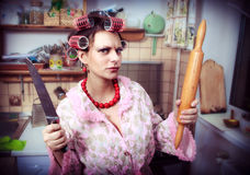 Housewife in an interior of the kitchen Royalty Free Stock Images