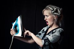 Housewife with iron Royalty Free Stock Images