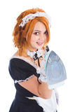 Housewife with iron in hand Royalty Free Stock Image