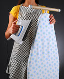 Housewife With Iron and Ironong Board Royalty Free Stock Image