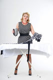 Housewife with iron Royalty Free Stock Photo