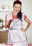 Housewife with iron Stock Images