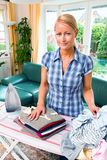 Housewife ironing Stock Images