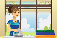 Housewife ironing clothes Stock Photos