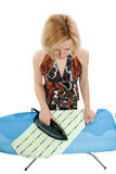 Housewife ironing clothes Royalty Free Stock Images