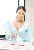 Housewife ironing clothes Stock Images