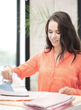 Housewife ironing clothes Stock Photography